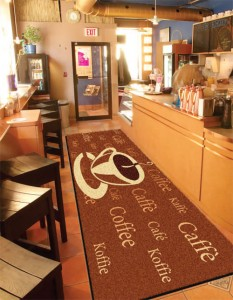 A custom printed carpet mat in a coffee shop