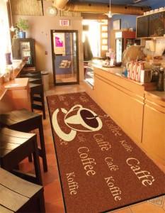 A custom printed carpet mat in a coffee shop