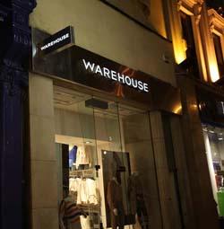 Illuminated Letters on Warehouse Cork Shop at Night